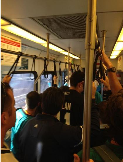 Sharks fans taking VTA light rail to a game.