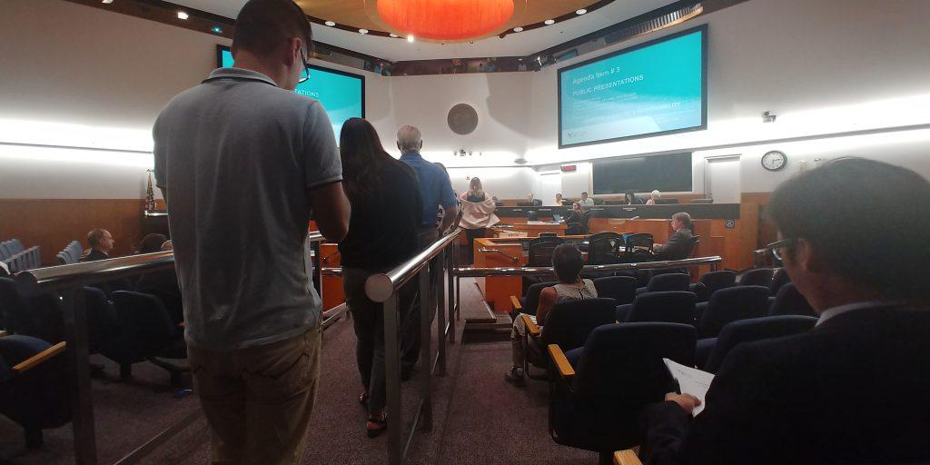 People wait to speak at a VTA Board meeting in San Jose.
